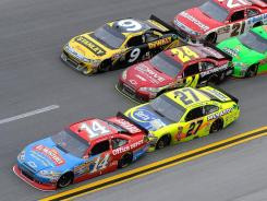 Tony Stewart (14) says even though Paul Menard (27) pushed him in the final laps at Talladega, the RCR driver was told not to push him enough to contend for a win (Childress drivers Clint Bowyer and Jeff Burton finished 1-2; Stewart was seventh).