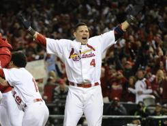 Yadier Molina celebrates a 10-9 victory over the Rangers in Game 6.