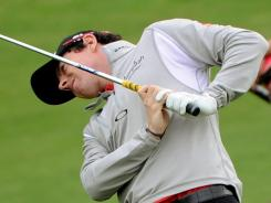 Rory McIlroy of Northern Ireland watches his approach shot during the first round of the Shanghai Masters.