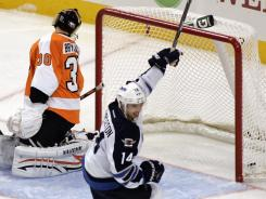 Flyers goalie Ilya Bryzgalov looks behind as Mark Stuart (not shown)  scores to erase a third-period lead.