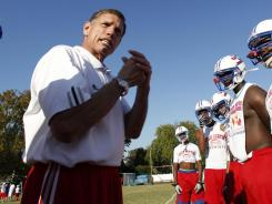 John Curtis Christian coach John Curtis Jr. talks to his team at a recent practice. On Thursday, Curtis became just the second high school football coach to reach 500 career victories.