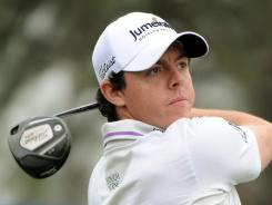 Rory McIlroy of Northern Ireland tees off at the 18th hole Friday in the  Shanghai Masters.