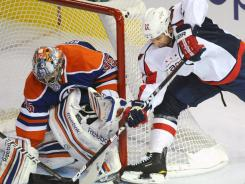 Oilers goalie Nikolai Khabibulin saved 34 shots, denying Alex Ovechkin seven times to hand the Capitals their first loss of the season.