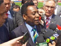 Pele speaks with media at the Beira Rio Stadium in early October. The stadium will be renovated for the 2014 World Cup in Porto Alegre, Brazil. The three-time World Cup winner says that the country is not ready to host the 2014 competition.