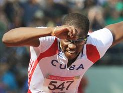 Cuba's Dayron Robles won the gold medal in the 110-meter hurdles, finishing in 13.10 seconds to set a Pan Am Games record.