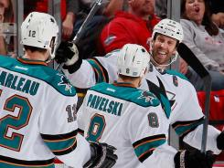 Joe Thornton, right, celebrates with Sharks teammates Joe Pavelski and Patrick Marleau after his second-period goal, one of his two scores in San Jose's 4-2 victory.