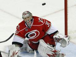 Hurricanes goalie Cam Ward eyes the puck during the second period of Carolina's game against the Chicago Blackhawks in Raleigh, N.C., on Friday. Ward had 30 saves in posting his first shutout of the season.