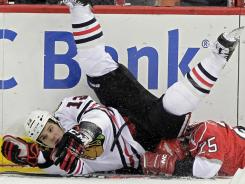 Chicago's Daniel Carcillo was suspended two games for this hit on Carolina's Joni Pitkanen.