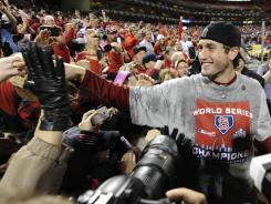 Third baseman David Freese, who grew up just outside St. Louis, spends some time with Cardinals fans following the club's World Series victory.
