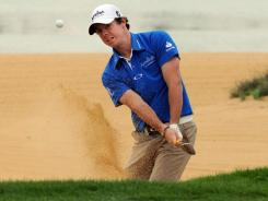 Rory McIlroy of Northern Ireland hits out of a bunker on the fourth hole during the third round of the Shanghai Masters.