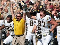 Missouri players and coaches celebrate after their 38-31 overtime defeat of Texas A&amp;M.
