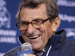 Penn State head coach Joe Paterno talks with reporters after recording his 409th career win.