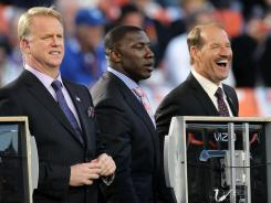Bill Cowher, at right with CBS colleagues Shannon Sharpe, center, and Boomer Esiason at Super Bowl XLIV in 2010, said he will stay at the network at least through next year.