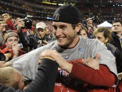 MVP David Freese celebrates the Cardinals' World Series with fans.