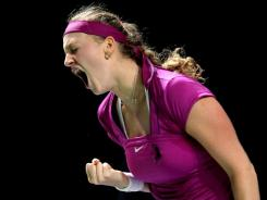 Petra Kvitova of the Czech Republic celebrates a point during her victory against Victoria Azarenka of Belarus.