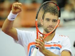 Marin Cilic of Croatia celebrates after beating Janko Tipsarevic of Serbia in the final of the St. Petersburg Open.