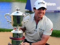 Rory McIlroy of Northern Ireland poses with the trophy after winning the Shanghai Masters.