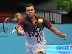 Jo-Wilfried Tsonga of France chases down a forehand during his victory Sunday against Juan Martin del Potro of Argentina.