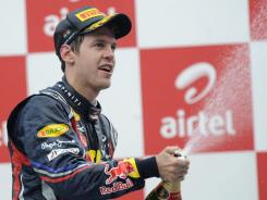 Sebastian Vettel celebrates his 11th win of the Formula One season, putting him within two of Michael Schumacher's record.