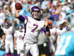 Minnesota Vikings quarterback Christian Ponder (7) throws the ball in the second quarter against the Carolina Panthers at Bank of America Stadium.