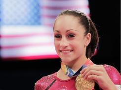 Jordyn Wieber of the United States poses with her gold medal after winning the women's all around final during the Artistic Gymnastics World Championship in Tokyo on Oct. 13.