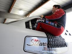 Tony Stewart climbs from his Stewart Haas Chevrolet during the NASCAR fuel injection test Monday at Martinsville Speedway.