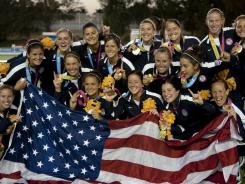 The U.S. field hockey team poses with their  gold medals after defeating Argentina 4-2 at the 2011 Pan Am Games. This was the first gold medal for the USA in women's field hockey.