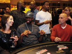 NBA free agent Tracy McGrady (with cap) spending time during the lockout at a charity blackjack tournament last month at the MGM Grand in Las Vegas.