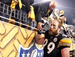 Pittsburgh Steelers defensive end Brett Keisel (99) celebrates with the fans after defeating the New England Patriots at Heinz Field.