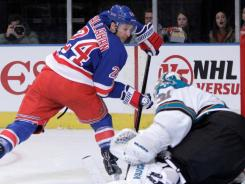 Ryan Callahan (24) had two goals and an assist to help the Rangers snap the Sharks' five-game win streak.