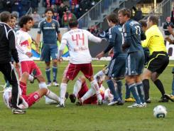 A fight breaks out between members of the New York Red Bulls and the Los Angeles Galaxy at the end of the game at Red Bulls Arena. LA won 1-0.