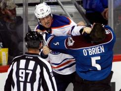Edmonton's Andy Sutton and Colorado's Shane O'Brien fight after the former's hit on Gabriel Landeskog.