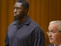 Detroit Pistons center Ben Wallace, left, pleaded guilty Tuesday to reduced misdemeanor charges of drunken driving and possessing a firearm while under the influence of alcohol.
