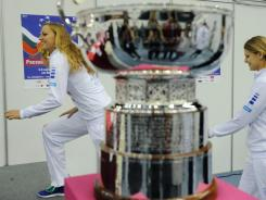 Petra Kvitova and Lucie Safarova arrive for a news conference in advance of this weekend's Fed Cup final.