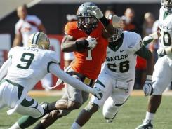 Oklahoma State and running back Joseph Randle will try to avoid an upset against No. 19 Kansas State.