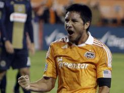 Houston Dynamo forward Brian Ching celebrates after scoring a goal against the Philadelphia Union in the first half of their Eastern Conference semfinal at Robertson Stadium in Houston on Thursday.