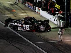 Kyle Busch heads to the garage at Texas Motor Speedway after NASCAR parked him for intentionally wrecking Ron Hornaday under caution during Friday's Trucks race.