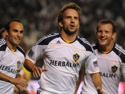 Los Angeles Galaxy forward Mike Magee, center, celebrates his goal against the New York Red Bulls with Landon Donovan, right, and Chad Barrett during the first half at the Home Depot Center in Carson, Calif.