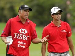 Tiger Woods' former caddie, Steve Williams, here with Adam Scott during the second round of the WGC-HSBC Champions event in Shanghai, caused a stir with his comments at an awards roast.
