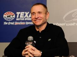 Mark Martin smiles at Texas Motor Speedway after it was announced he would run 25 races next year for Michael Waltrip Racing,