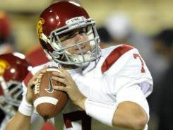 quarterback Matt Barkley tossed a record six touchdowns against Colorado on Friday as the Trojans thumped the Buffaloes 42-17.