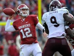 Oklahoma quarterback Landry Jones threw for two touchdowns as the Sooners beat Texas A&M.