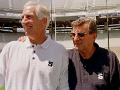 Former Penn State defensive coordinator Jerry Sandusky, at left with head coach Joe Paterno in Aug. 1999, has been accused of sexually abusing eight boys.
