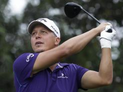Sweden's Fredrik Jacobson tees off from the second tee in the third round of the HSBC Champions tournament in Shanghai on Saturday. Jacobson shot a 67 and takes a two-shot lead into the final round.