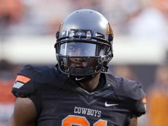 Oklahoma State wide receiver Justin Blackmon and the Cowboys rallied to top Kansas State 52-48 on Saturday.