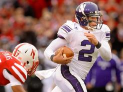 Kain Colter (2) relieved injured starter Dan Persa and ran for two touchdowns and threw for another score in Northwestern's upset of Nebraska.