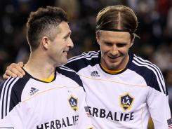 Los Angeles Galaxy teammates David Beckham, right, and Robbie Keane celebrate their victory over Real Salt Lake in the MLS Western Conference Championship on Sunday.