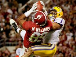LSU defensive back Eric Reid intercepts a pass intended for Alabama's Michael Williams during the fourth quarter.