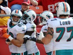 Dolphins TE Anthony Fasano (80) celebrates one of his two TDs on Sunday in Kansas City.
