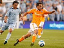 The Houston Dynamo's Danny Cruz finds space past the Sporting Kansas City defense during their Eastern Conference final at Livestrong Sporting Park in Kansas City. Cruz and the Dynamo won 2-0, advancing to MLS Cup.